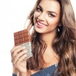 Girl with long hair and chocolate bar — Stock Photo