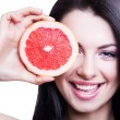 Cheerful girl with grapefruit — Stock Photo