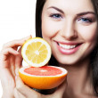 Happy girl with grapefruit and lemon — Stock Photo