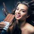 Stock Photo: Sexy smiling womwith chocolate and desire
