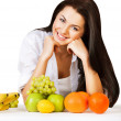 Smiling girl with fruits — Stock Photo