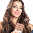 Woman with long hair and chocolate bar — Foto de Stock
