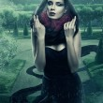 Mysterious woman in black hood in garden — Stock Photo