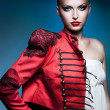 Adult beautiful blonde woman in red jacket with red lips — Stock Photo