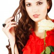 Close-up portrait of pretty sexy woman with rose and curly hair — Stock Photo