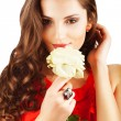 Pretty woman in red dress with rose — Stock Photo