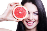 Cheerful girl with grapefruit — Stok fotoğraf