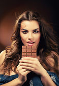 Sexy passionate woman with chocolate — Stock Photo