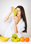 Sexy woman with grape in hands — Stok fotoğraf