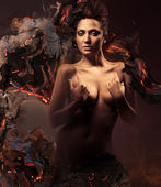Sexy nude woman in dark and burning paper — Stock Photo