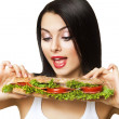 Funny woman looking at long sandwich — Stock Photo