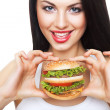 Cute happy girl holding hamburger - Stock Photo
