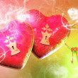 Saint Valentine's Day flying pink hearts attacked by cupids - Stock Photo
