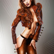Sexy music insrument woman in brown jacket - Lizenzfreies Foto