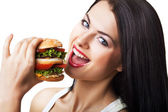 Happy cute woman eating hamburger — Stock Photo