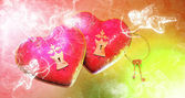 Saint Valentine's Day flying pink hearts attacked by cupids — Stock Photo