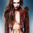Pretty beautiful erotic violin woman in brown jacket — Stock Photo