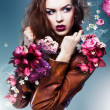 Stock Photo: Pretty attractive erotic womin brown jacket with flowers