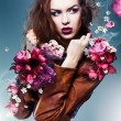 Pretty attractive erotic woman in brown jacket with flowers — Stock Photo #15260039