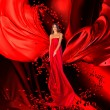 Goddess of love in long red dress with magnificent long hair — Stock Photo #15260721