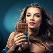 Royalty-Free Stock Photo: Sexy beautiful woman with chocolate and wind
