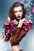 Pretty attractive erotic woman in brown jacket with flowers — Stock Photo