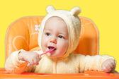 Baby boy eating oatmeal — Stock Photo