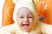 Baby boy smiles his widest smile ever as he laughs while sittin — Stock Photo