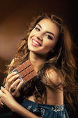Smiling woman and chocolate bar — Stock Photo