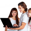 Three friends with laptop — Stock Photo