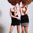 Stock Photo: Two girls with big curly heart-shaped hairstyle