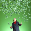 Stock Photo: Businessman catchs flying banknotes