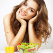 Stock Photo: Young cute womwith juice and salad