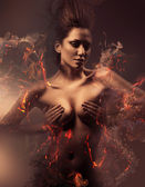 Burning erotic sexy beautiful woman in dirty mist — Stock Photo
