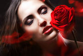 Woman with rose — Stock Photo