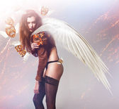 Beautiful sexy woman with wings and flying masks — Stock Photo