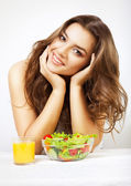 Young cute woman with juice and salad — Stock Photo