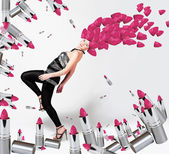 Girl with pink lipsticks on the head — Stock Photo