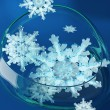 Crystal snowflakes in glass vase — Stock Photo