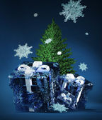 Frozen christmas gifts and fir-tree — Stock Photo