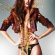 Pretty gorgeous erotic woman in brown jacket and panties with go — Stock Photo