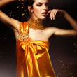 Sensual woman in yellow dress — Stock Photo