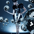 Attractive african woman with disco ball in her right hand - Stock fotografie