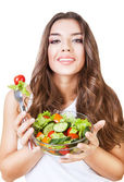 Hungry beautiful woman with salad — Stock Photo