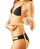 Happy woman after diet with measures in swimsuit — Stock Photo