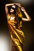 Sensual adult woman in yellow dress — Stock Photo