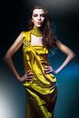 Sensual beautiful woman in long yellow dress — Stock Photo
