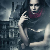 Sexy woman in black hood and castle — Stock Photo