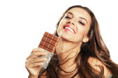 Woman and chocolate in hand — Stockfoto