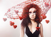 Portrait of woman with face art and love net with hearts — Stock Photo